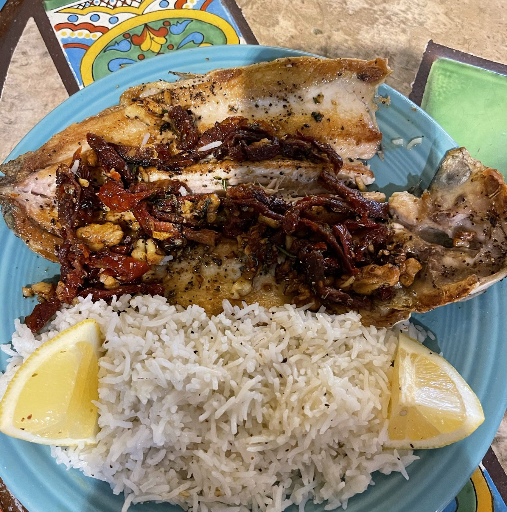 A head and tail on fish prepared to order. Seasoned with an array of flavors to include fennel, lemon, garlic and herbs. Served on a bed of rice.